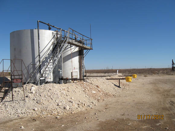 Image of Tank battery with caliche burm and above ground load line containment